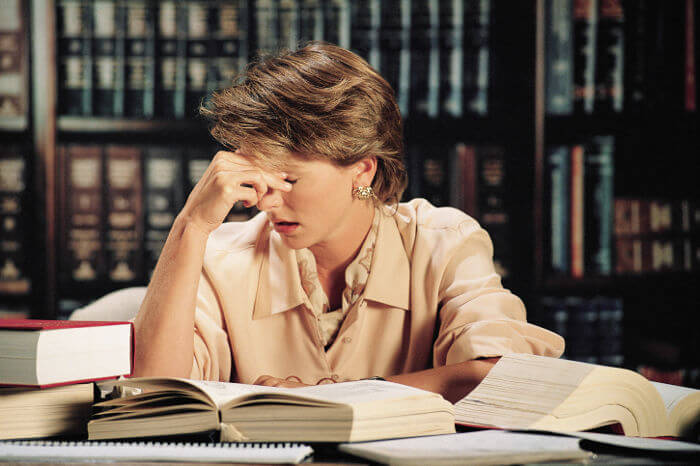 Montagna-Law-Tired-Attorney-with-Headache