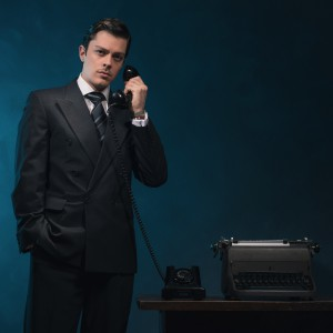 Retro 1940s business man in suit and tie on the phone.
